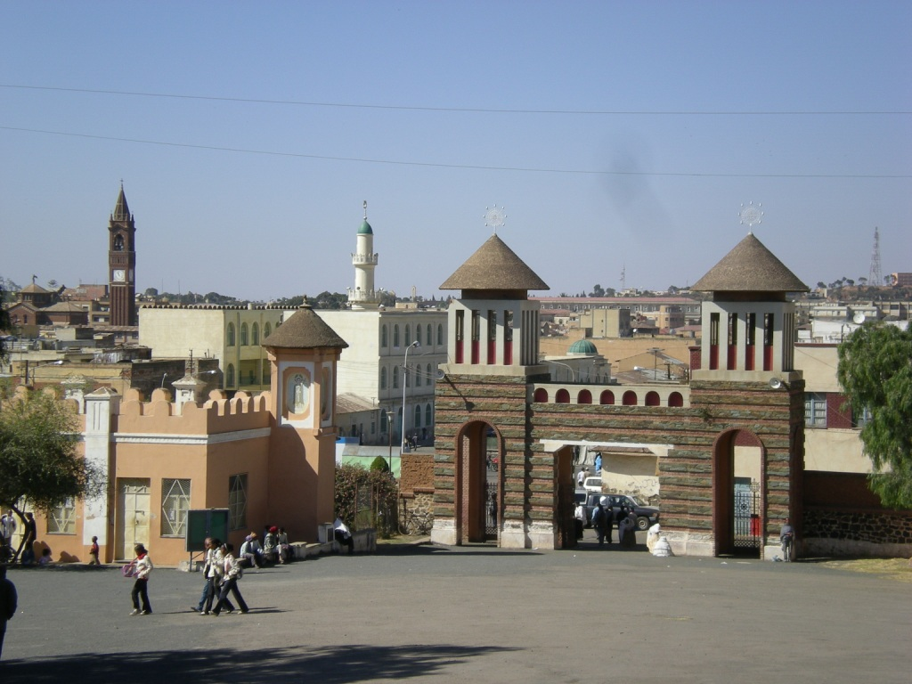 St Mary Orthodox Church (foreground), Asmara, a blend of Eritrean and Italian architecture; the Roman Cathedral and Grand mosque in the background