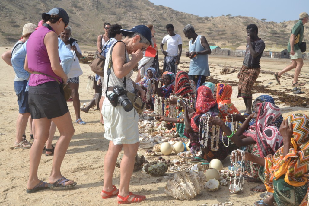 Tourists buying sea shells and beads from Afar tribes, Dissie Island
