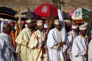 Colorfully clad priests and umbrellas at Timket Festival